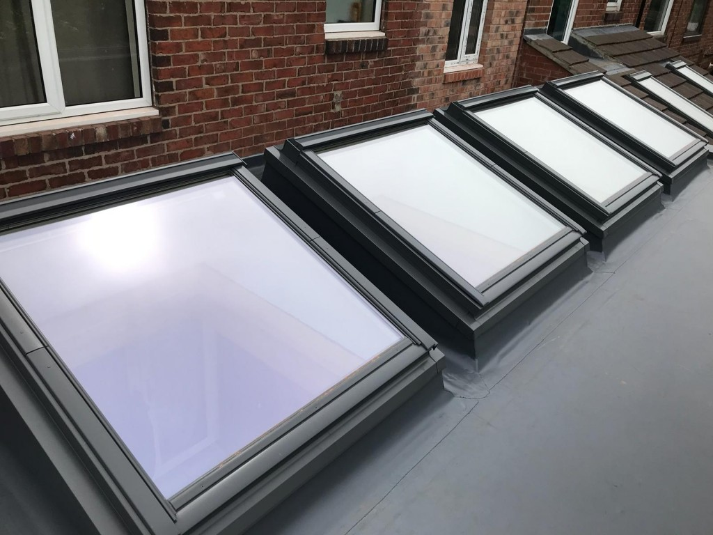 External view x 4 large velux windows set into insulated roof kerbs.